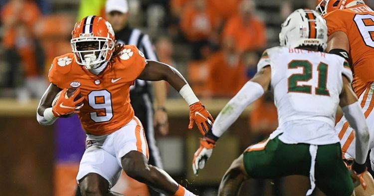 Etienne seeks yardage against the Canes. (Photo courtesy of ACC)